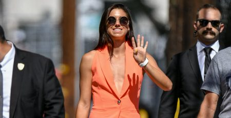 Alex Morgan's Orange Suit Isn't Even the Brightest Part of Her Outfit - It's Those Metallic Heels!